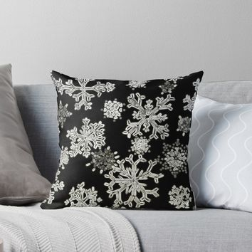 'Snowflakes (black)' Throw Pillow by AdrianaMijaiche