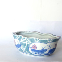 Vintage small asian ceramic planter. Floral pottery flower pot. Lotus flowers are painted on the outside.