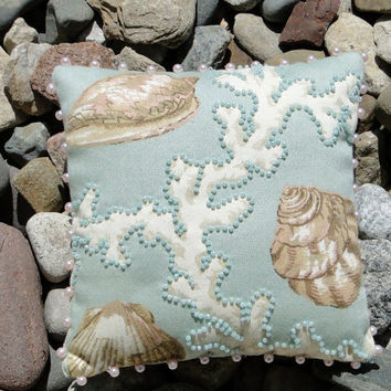 Seashell and White Coral Aqua Pillow with Pink by thebeadedpillow