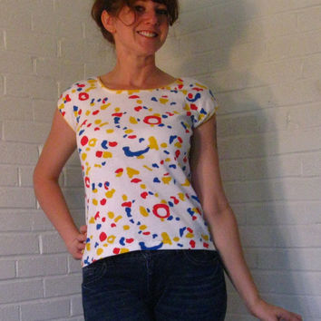 Best 1980s Tee shirt. Primary colors, Leopard print, Cap sleeves. Medium.