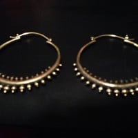 Small brass gypsy dancer hoop earring