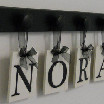 Baby Girl Room Decorations Hanging Wood Plaque - NORA Includes 4 Pegs Hanger Painted Black. Baby Name Art Nursery Decor