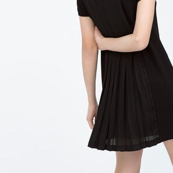 Back pleated dress