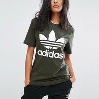 adidas Originals Khaki Trefoil Boyfriend T-Shirt at asos.com