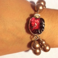 Lush rasperry vintage button sterling clasp and rich bronze pearl bracelet