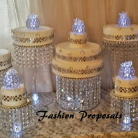 Wedding Cake Stand Cascade waterfall crystal set of 9 wedding acrylic cake stands with a battery operated LED light.