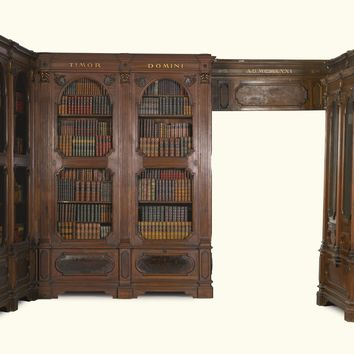 An Italian carved walnut and parcel-gilt bibliothèquein baroque style | lot | Sotheby's