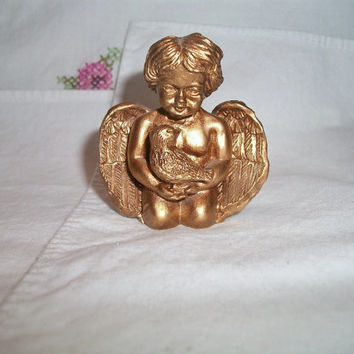 gold cherub candle stick holder