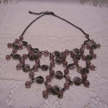 A Vintage Bib Necklace With Lots of Wire Work and Light Mauve  Beads