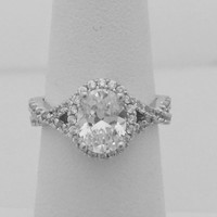 Halo Oval CZ Engagement Ring on a Twisted Shank Ring Setting