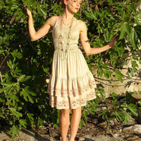 Beautiful romantic cotton dress in beige with flounce and lovely lace decorated with Rodonit stones, with a matching necklace.