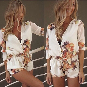 V-NECK WHITE PRINTED DRESS JUMPSUITS
