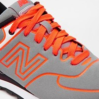 New Balance 574 Gray Neon Orange Sneakers