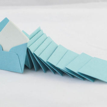 Mini turquoise/aqua envelopes with tiny note cards 1x1.5""