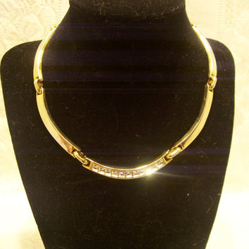 Shine Like A Star In This Gold Tone and Crystal Choker Necklace.
