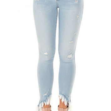 Light Wash Mid Rise Slanted Fray Skinny Jeans