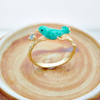 Blue Topaz Ring with tweeting bird on branch by glamsenses on Etsy