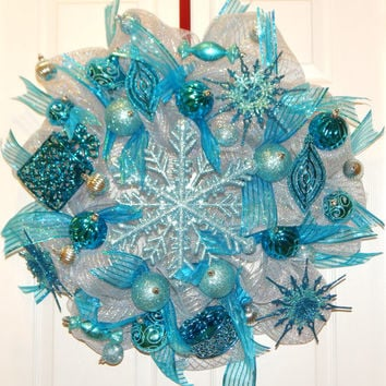 Deco mesh Christmas wreath with snowflake, ribbon and filled with ornaments