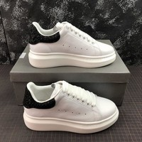Alexander Mcqueen Oversized White Calf Leather Lace-up Sneakers With Black Glittered Heel Patch - Best Online Sale
