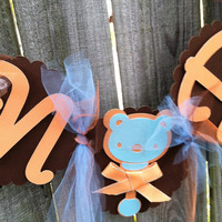 Baby shower banner: brown and orange
