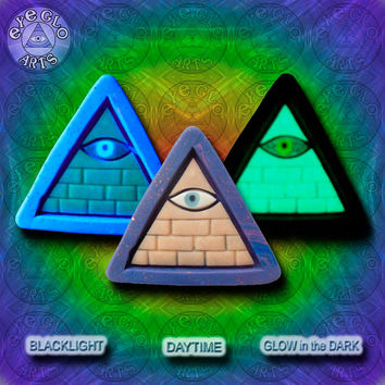 EyeGloArts purple gold GLOW in the dark jewelry Illuminati all seeing eye pyramid pendant clubwear blacklight Psytrance rave candy