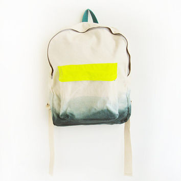 forest green backpack with neon yellow pouch