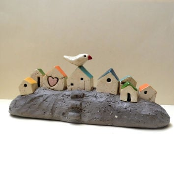 Ceramics and pottery sculpture , handmade ceramic sculpture of miniature houses , rustic style houses , ceramic bird / naïve Israeli art