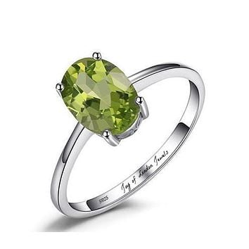 A Natural 1.2CT Oval Cut Green Peridot Solitaire Engagement Ring