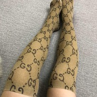 GUCCI  Gold thread, graffiti, long knee socks