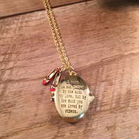 Wizard of Oz Necklace A Heart is Not Judged by How Much You Love Locket