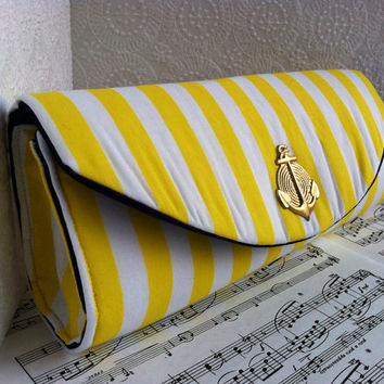 Yellow and white striped nautical clutch bag with brass anchor