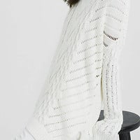 Oversized Open Cable Knit Tunic Sweater from EXPRESS