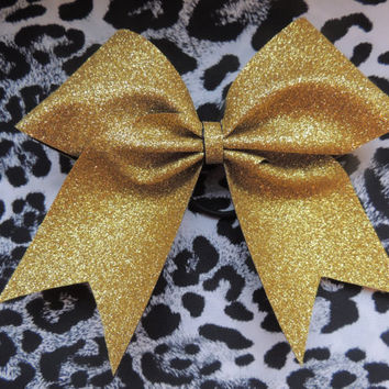 Gold glitter cheer bow.