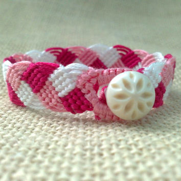 Friendship Bracelet-Pink, Maroon and White Braided Pattern with a flower Button