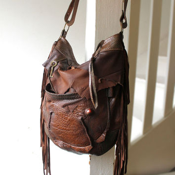 Distressed chestnut brown leather fringed hobo bag fringe artistan distressed purse bohemian african raw snake leather festival free people