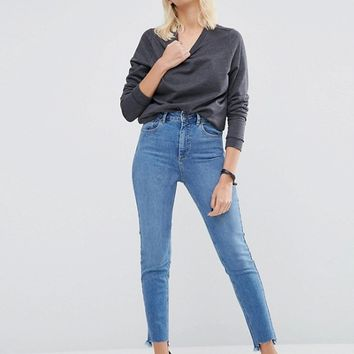 ASOS FARLEIGH Slim Mom Jeans In Jecca Pretty Midwash Side Tabs with Split hem at asos.com