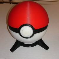 Pokemon Pokeball with hinged lid and stand.