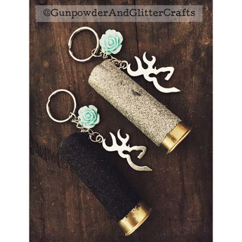 Black Glitter or Silver 12 Gauge Shotgun Shell Keychain with Browing Symbol and Teal Flower