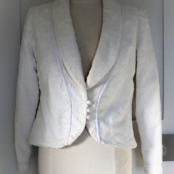 Vintage faux fur fitted ivory jacket from 1960's with button detailing and trimmings. Size 10 /12. Appears handmade of a high quality