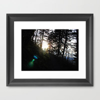 Lens flare through the trees Framed Art Print by Gary Lee Hutchings