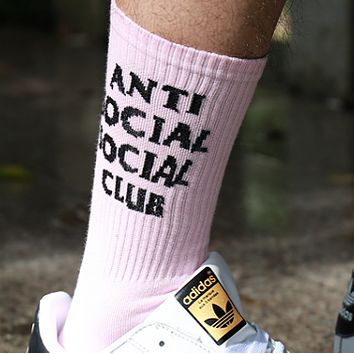 Anti social club Men and women in black and white wild skateboarding in the tube socks