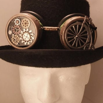 Steampunk goggles!  Hand embellished with antique looking bicycle, gears and watch piece