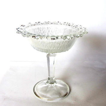 Vintage ornate glass footed candy dish. Clear glass trinket bowl. Flower shaped glass dish. Made in Italy.