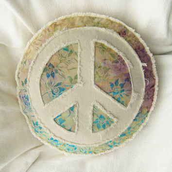 Peace sign applique boho pillow on multi color tropical floral batik with aqua, yellow and purple with distressed natural denim round pillow
