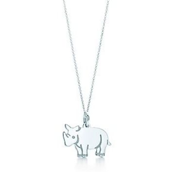 Tiffany & Co. -  Rhinoceros tag charm in sterling silver on a chain.