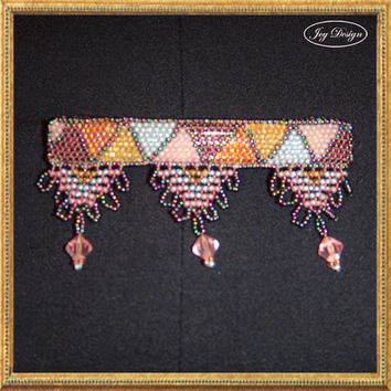 BLAIR is a vintage barrette decorated with loomed multi colored iridescent glass and seed beads