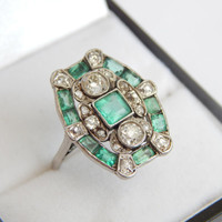 art deco emerald ring with old cut diamonds in white gold
