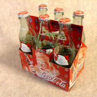 6 Pack Coca-Cola 1994 Happy Holiday Coke Bottles and Matching Carton - Empty but with Lids.