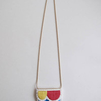 Abstract embroidered necklace on matte gold tone ball chain. Summer 2017 colors in bright blue, red, and yellow An Astrid Endeavor