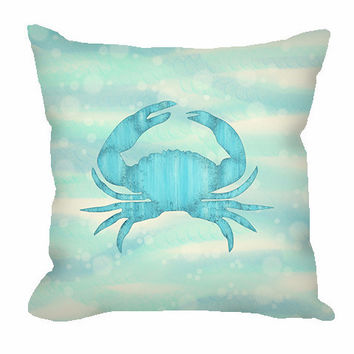Nautical Throw Pillow with blue crab on aqua sea and sand